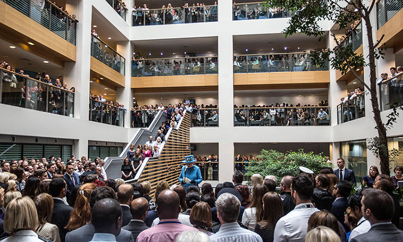 "She's still got it! Try to spot Queen Elizabeth in this massive crowd at the Home Office building in London. The monarch told the group, ""A life of public service is an honorable calling: you shape people's lives and inspire others.""  