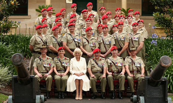 Standing out from the crowd, Camilla was all smiles as she posed with members of the Royal Australian Corps of the Military Police in Sydney.<br>