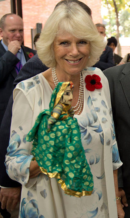 Camilla held a doll during her visit to the Doon School in Dehradun in November 2013. 
