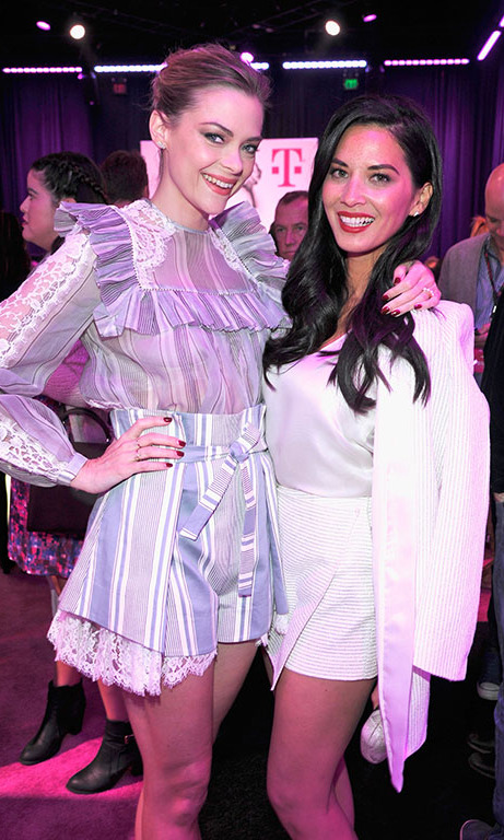 November 10: Olivia Munn and Jaime King hung out back stage at T-Mobile's Un-Carrier X launch party and concert at the Shrine Auditorium in Los Angeles. 
