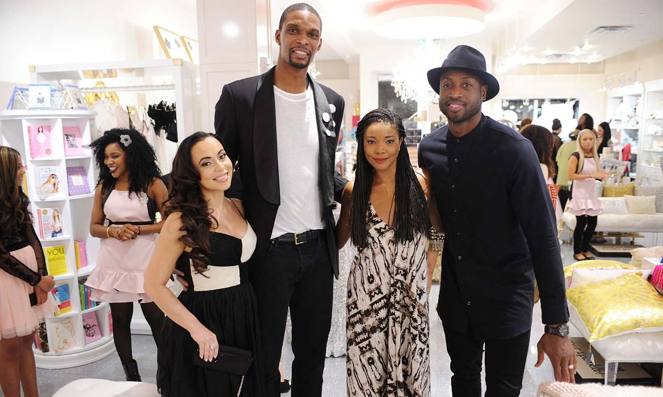 November 9: Bring the heat and fashion!  Gabrielle Union and Dwyane Wade helped Chris Bosh and his wife Adrienne Bosh celebrate the grand opening of her new boutique Sparkle and Shine Darling in Miami.  