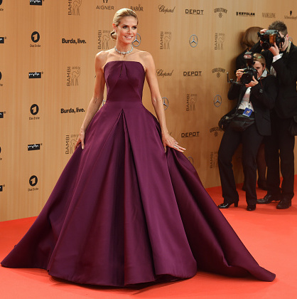November 12: Returning to her native country of Germany, Heidi Klum had all lenses on her as she arrived wearing a dramatic purple Zac Posen gown at the Bambi Awards in Berlin.