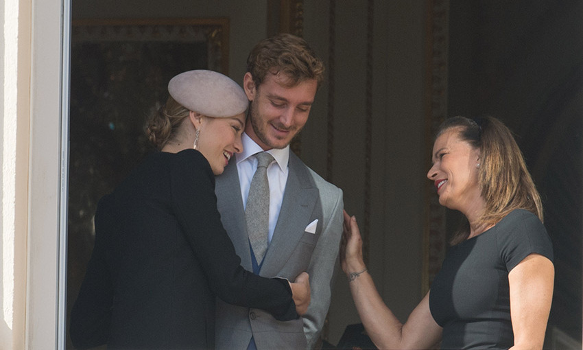 Pierre Casiraghi was surrounded by love on the Princely Palace balcony on Monaco's National Day, cuddled by his wife Beatrice Borromeo and his aunt Princess Stephanie.