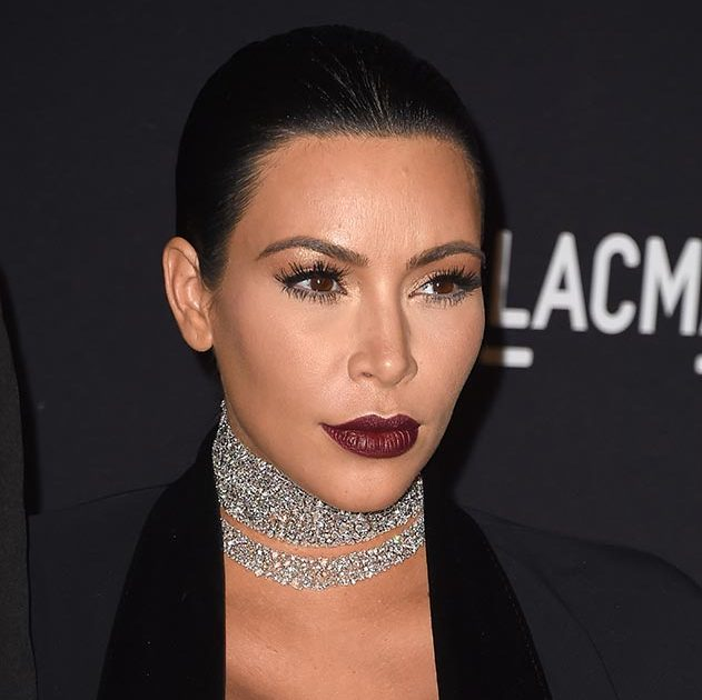 Kim Kardashian shows how to toughen up a beauty look with eyeliner paired with long lashes on top and bottom and the season's hottest trend, dark berry lips.