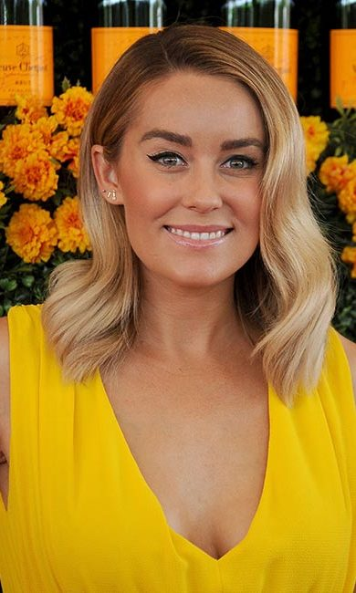 Simple, yet beautiful! Lauren Conrad completes her fresh-faced 1960s look with eyeliner swept across her eyelid and thickening the line before finishing it off with a cat flick.