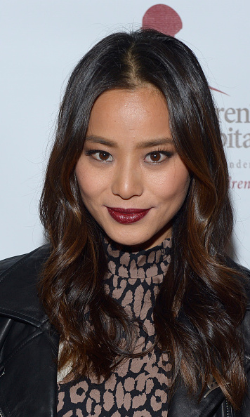 "To create Jamie Chung's alluring look, keep the eyes simple with natural colors and go for a bold deep burgundy pout. ""I like defined brows, diffused eyes, and a bold lip,"" she told byrdie.com.