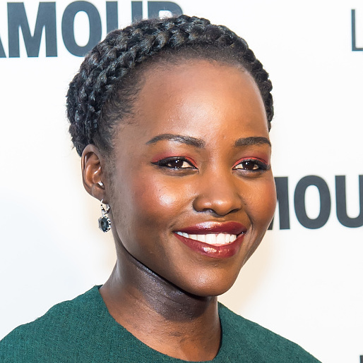 Lupita Nyong'o draws attention to her beautiful brown eyes with a subtle cat-eye and Lancôme eyeshadow in Ruby Affair.