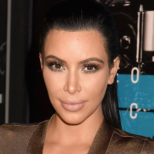 If you want to focus on your makeup, take a page out of Kim Kardashian's book and show off your edgy side with a slicked-back pony.