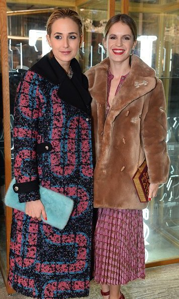 Coat goals! Princess Elisabeth and heiress Eugenie Niarchos showed their cool winter style at the Tiffany & Co. Dover Street Market launch in London. 
