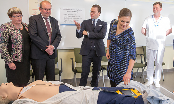 Crown Princess Victoria of Sweden checked out the latest in medical gear as she and husband Prince Daniel, center, visited a clinic in Varmland.