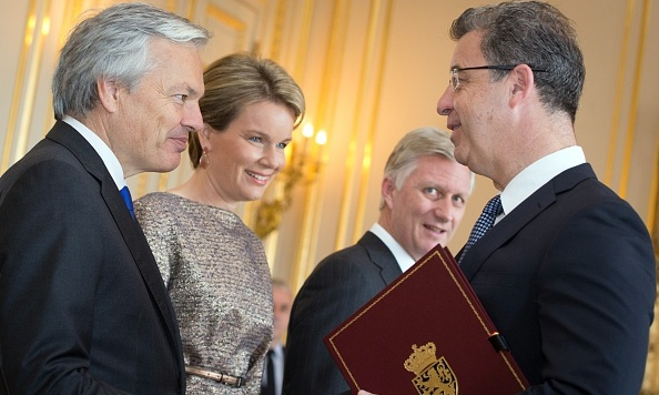 Queen Mathilde and husband King Philippe (second from right) looked on as Foreign Minister Didier Reynders and Baron Serge Brammertz chatted during a nobility ceremony at the royal palace. 