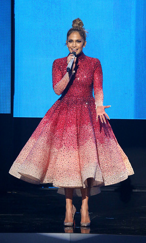 "Pretty in pink! The night's host J.Lo donned 10 different outfits during the show. The singer told viewers, ""My dream has come true.""