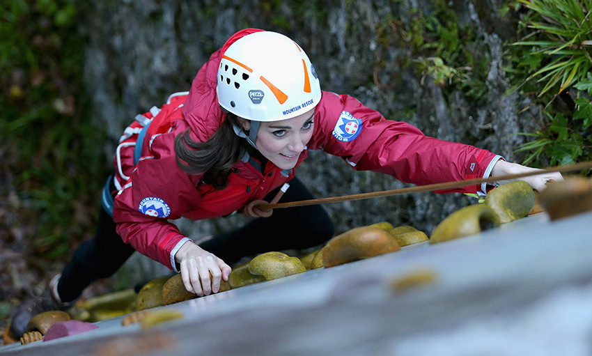 Action Kate! The Duchess of Cambridge scales a climbing wall during her visit to Wales. <br>Photo: Getty Images