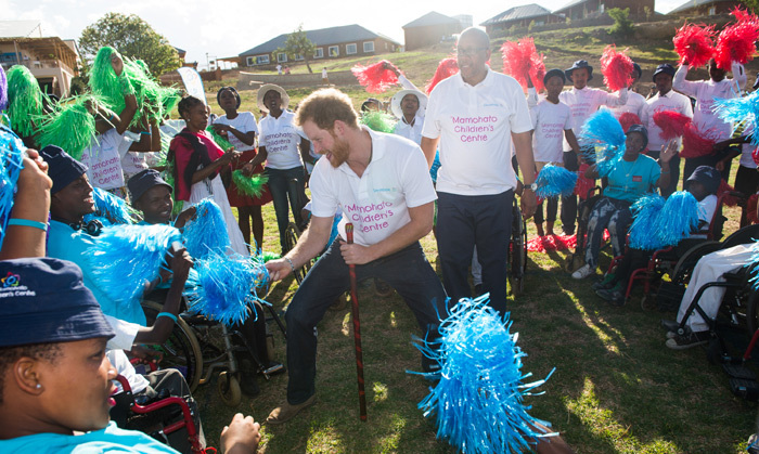 Party animal Harry quickly made his way into the center of the Sentebale 'flower' and began to dance and entertain the children.