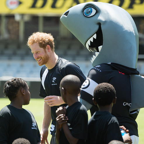 Shark attack! The young royal hung with some kids and The Shark mascot in Durban.
