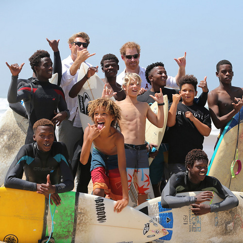 Hang loose! Harry posed with surfers at Durban beach. The prince was on hand to watch Surfers Not Street Children participants demonstrate their surf skills.