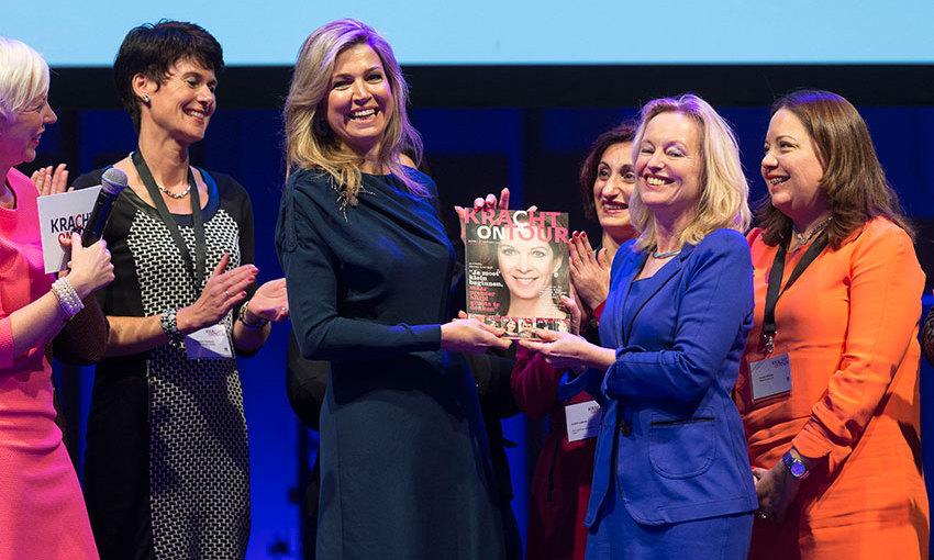Looking very sophisticated in a a dark blue dress by Danish designer Claes Iversen, Queen Maxima of the Netherlands received the first copy of the 'Kracht on Tour Magazine' from Education Minister Jet Bussemaker  during financial support workshops for women in The Hague Netherlands. 