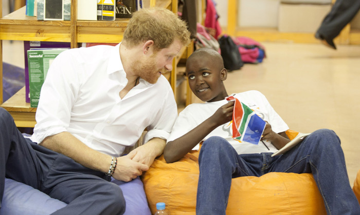 Prince Harry hung out with Prince Mtimkulul when he visited the Siyabonga Secondary School. During the visit, the royal also met with children participating in the Nelson Mandela Champion program in Soweto.