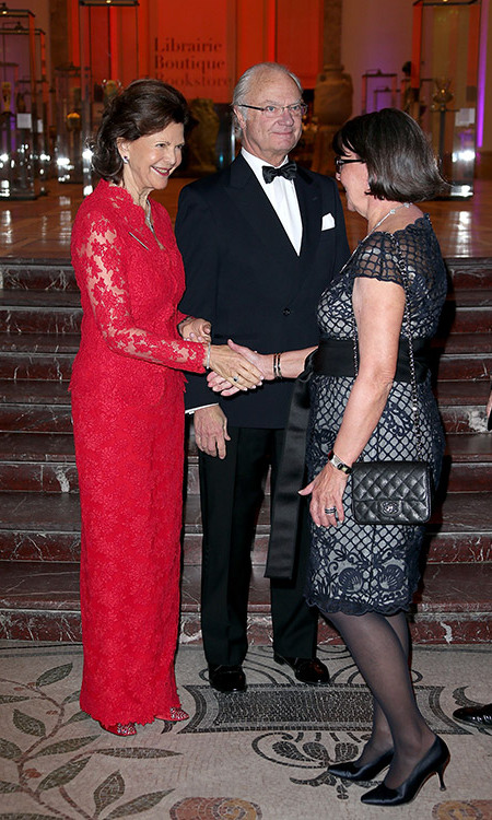Queen Silvia of Sweden glammed up in red lace for the Swedish Chamber of Commerce's Centenary Celebrations in Paris.