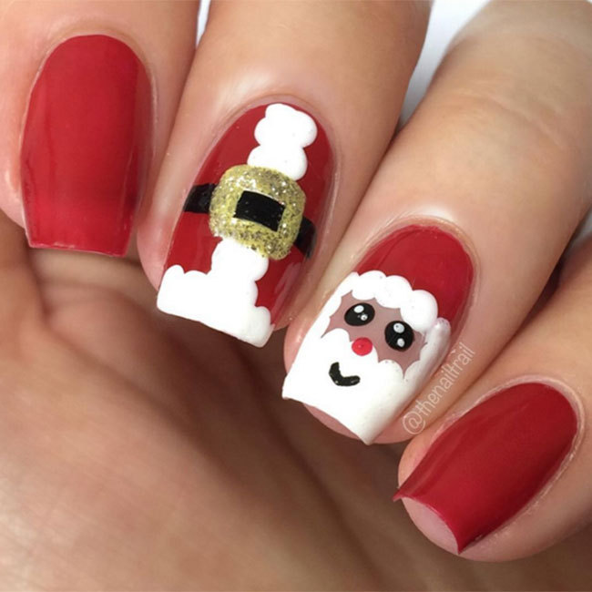 Hannah from The Nail Trail created this quirky Santa Claus design on a red base, applying white polish with a dotting tool.