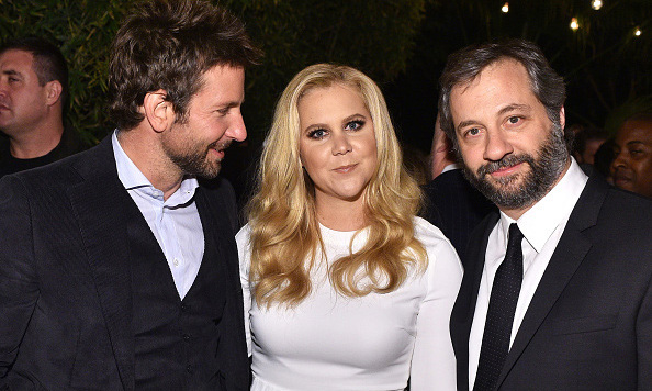 December 3: Swoon! Amy Schumer kept it together while standing next to Bradley Cooper and Judd Apatow at the GQ 20th anniversary 'Men of the Year' party at Chateau Marmont in West Hollywood. 