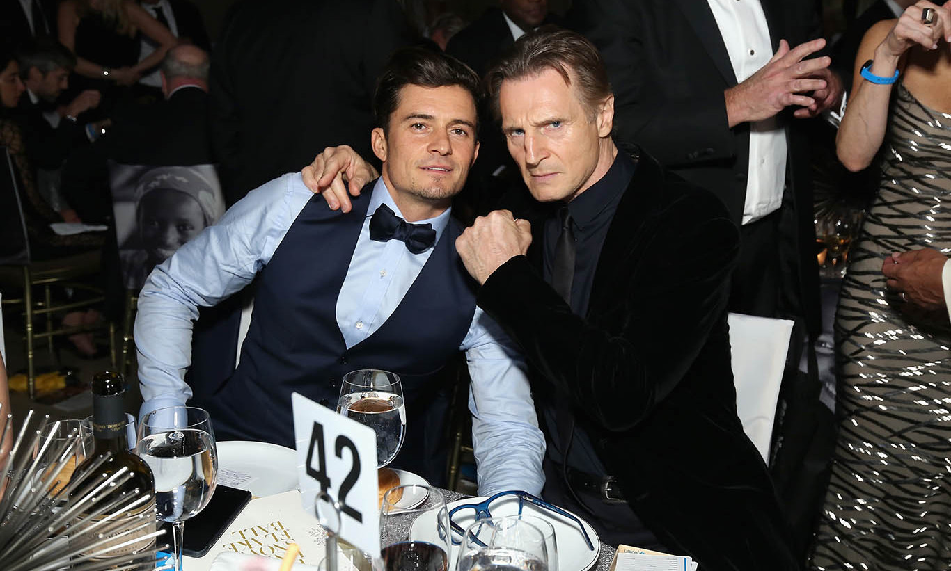December 1:  Boys will be boys! Liam Neeson and Orlando Bloom posed for a playful shot at the 11th Annual UNICEF Snowflake Ball in New York City.
