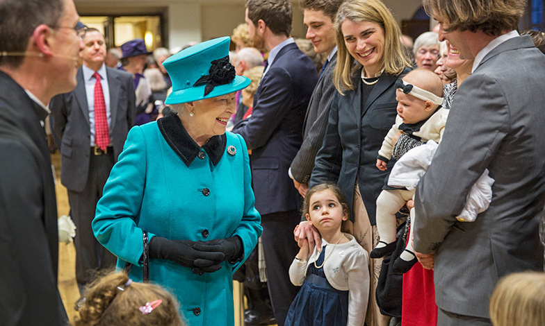 Queen Elizabeth attempted to cheer up a grumpy baby during a visit to St. Columba's Church in Knightsbridge, London. <br>Photo: Getty Images