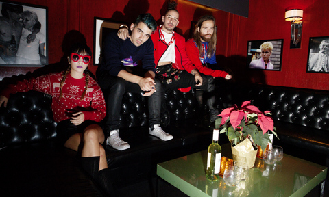 December 4: Joe Jonas with his band DNCE threw a holiday party sponsored by URLO Wines at The Continental Club in L.A. where everyone had to wear fun holiday sweaters.