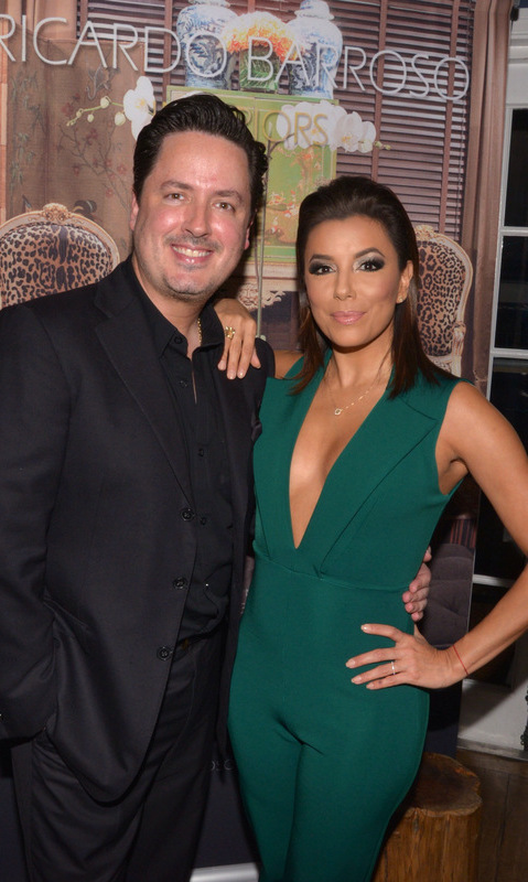 December 3: A little South Florida rain couldn't stop Eva Longoria. The actress stepped out with her pal Ricardo Barroso to celebrate the release of his new book, 'Ricardo Barroso Interiors' at Casa Tua in Miami.