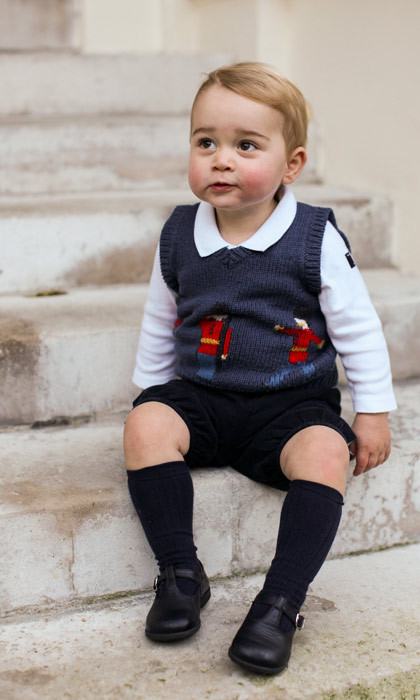 December 2014: What a cutie! The Prince showed off his sweet grin in his official Christmas pictures.