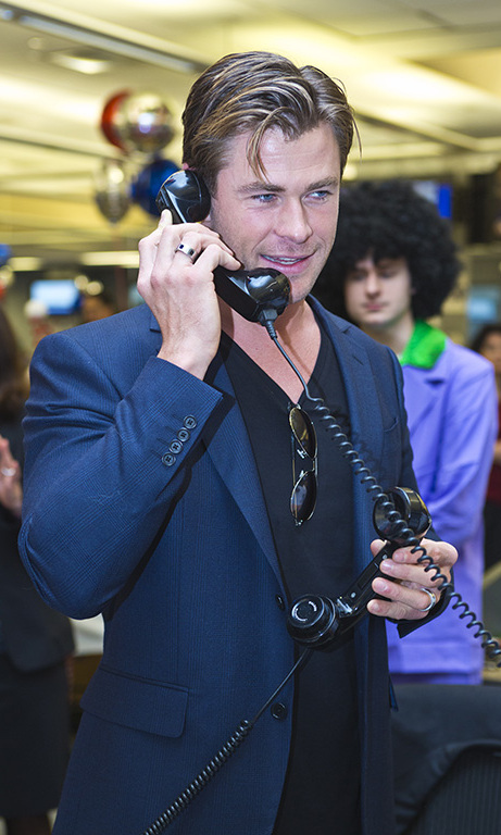 December 9: Chris calling! Chris Hemsworth worked the phone during the ICAP's 23rd annual global Charity Day at the firm's Jersey City office. Across the pond, Prince William and Kate Middleton also took part.
