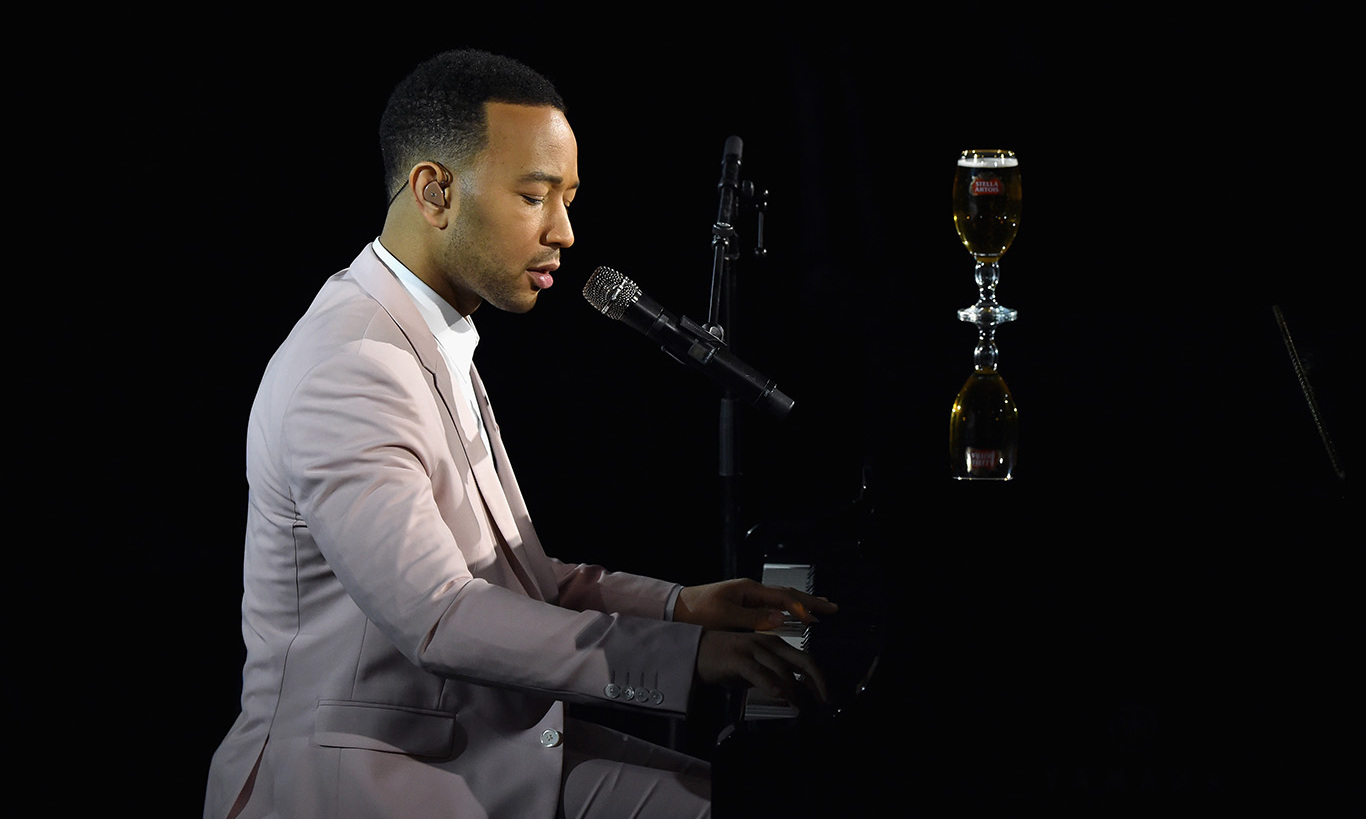 "December 9: Spreading the holiday cheer! John Legend performed his new holiday song ""Under the Stars"" written exclusively for Stella Artois at the unveiling of ""Stars"" in New York City. To listen, visit StellaArtois.com.