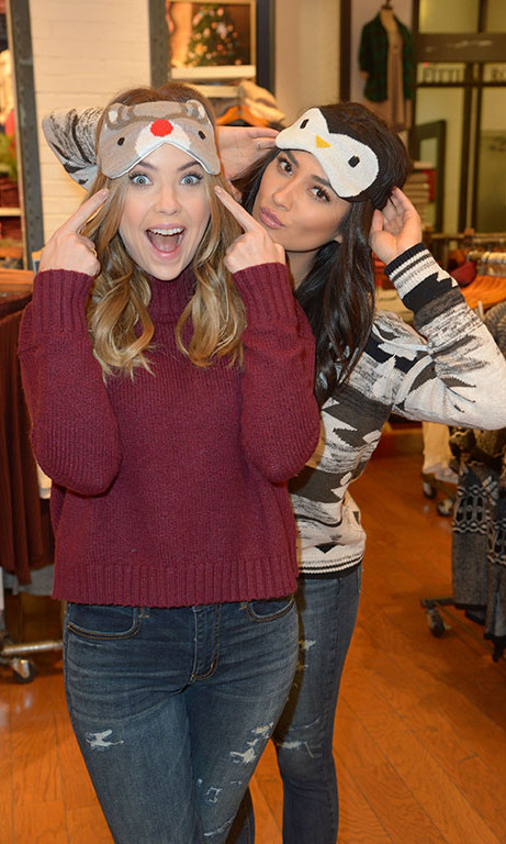 December 8: Pretty little holiday! Ashley Benson and Shay Mitchell tried on some of American Eagle's new winter wear while shopping at the store's Hollywood locaton.