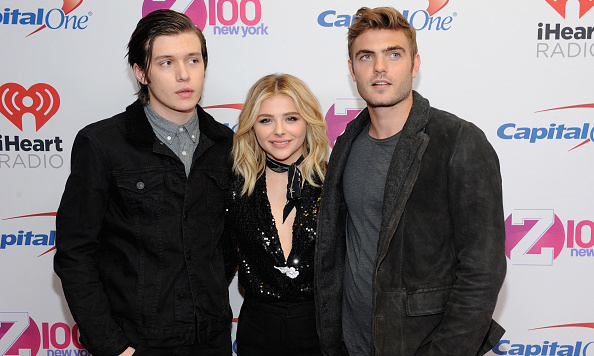 December 11: 'The 5th Wave's Chloe Grace Moretz had her arms full on the red carpet thanks to her handsome co-stars Alex Roe, right, and Nick Robinson.