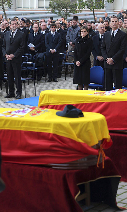 In Madrid, a solemn King Felipe and Queen Letizia of Spain, top right, mourned two Spanish policemen killed by the Taliban in Afghanistan.