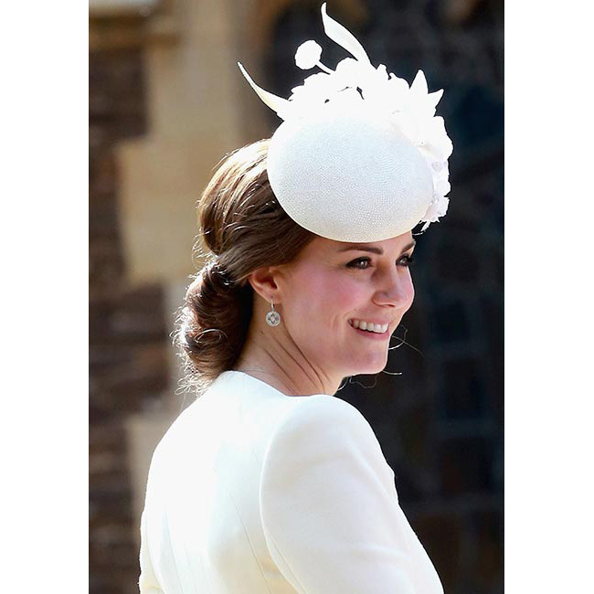 The Duchess of Cambridge was the epitome of elegance for daughter Princess Charlotte's christening. The 33-year-old opted for smoky eyes, sweeping her hair into a low bun and accessorizing with a chic cream Jane Taylor hat to match her Alexander McQueen dress coat.