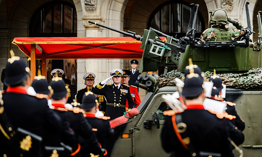 King Willem-Alexander of the Netherlands saluted the Marine Corps as they marched past the town hall in Rotterdam.
