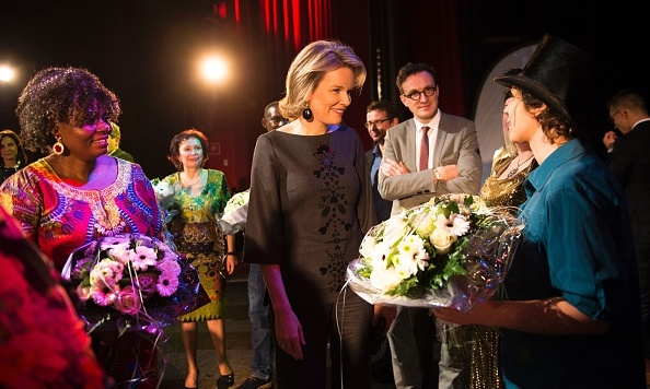 In the spotlight! Belgium's Queen Mathilde went backstage during a visit to the Maks organization in Brussels.