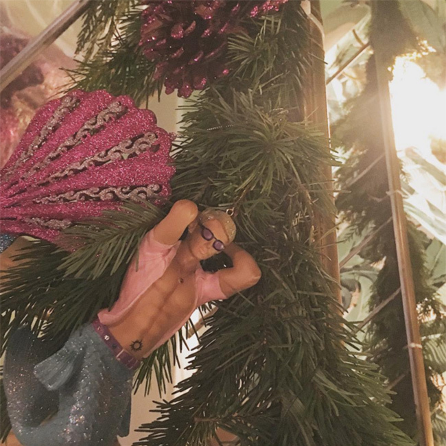 Lady Gaga marked Christmas at her house with a little extra eye candy on her tree. 