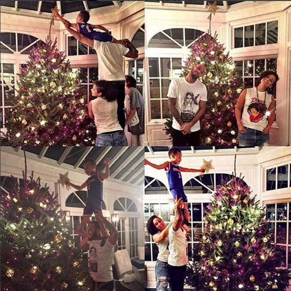 Alicia Keys made decorating her multi-colored tree a family affair, and of course it was her son's job to add the topper. 