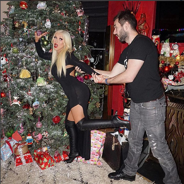 Christina Aguilera  and Matthew Rutler got a little naughty in front of their festive Christmas tree. 