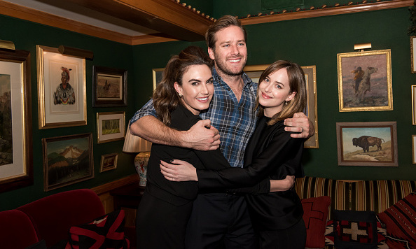 December 19: Armie in the middle! Armie embraced wife Elizabeth Chambers and Dakota Johnson at the Audi Q7 Holiday and Snow Polo Celebration in Aspen, Colorado.