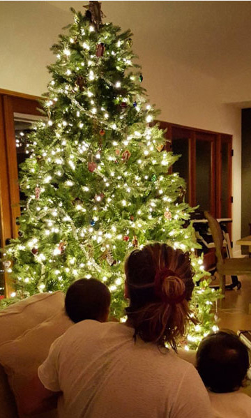 Two babies and a tree! Zoe Saldana shared this adorable pic of her sons Cy and Bowie and her husband Marco staring at their festive tree at 5 a.m. 
