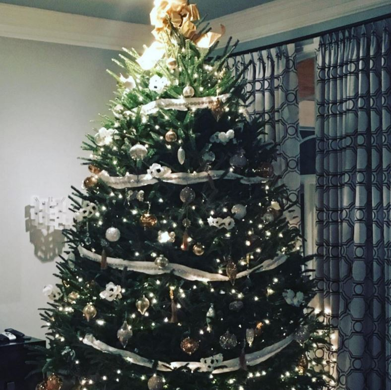Never too late... for a Christmas tree! Kate Upton showed off her gold and white creation.