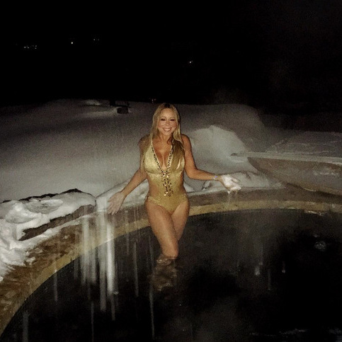 "Talk about a polar plunge! Mariah Carey is creating ""winter moments"" while vacationing in Aspen.