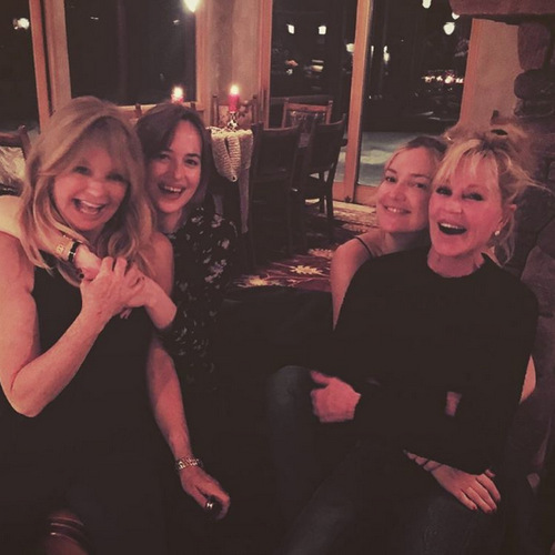 Mom swap! Dakota Johnson traded her mom Melanie Griffith for Kate Hudson's mom Goldie Hawn, while vacationing in celebrity hot spot, Aspen, Colorado.