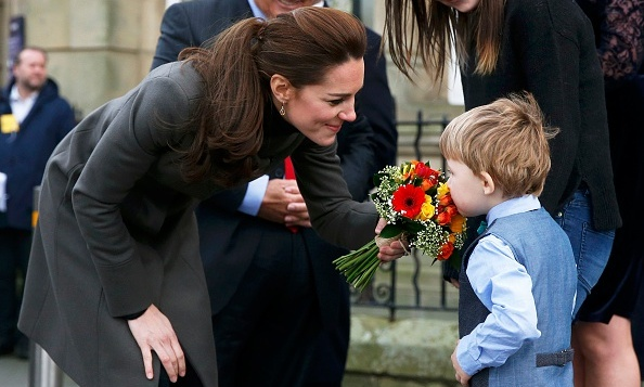 The Duchess received a fresh bouquet of flowers from a young boy while visiting the GISDA centre in Wales.
