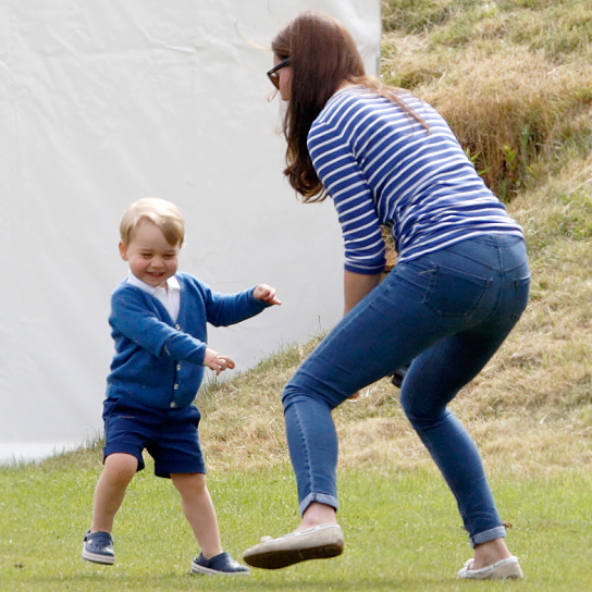 Kate played around with son Prince George during the Gigaset Charity Polo Match.