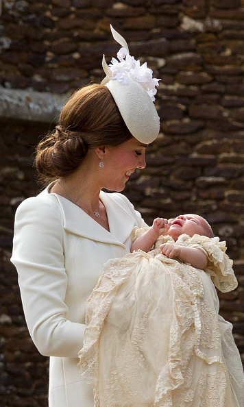 The proud mom shared a tender moment with daughter Charlotte during the little princess's christening.