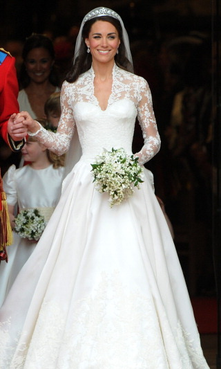 And of course her wedding gown. For her 2011 wedding to Prince William, Kate wore a timeless bridal gown created by Sarah Burton for Alexander McQueen that featured long lace sleeves, a plunging V-neckline and a show-stopping two meter train. Talk about a statement!